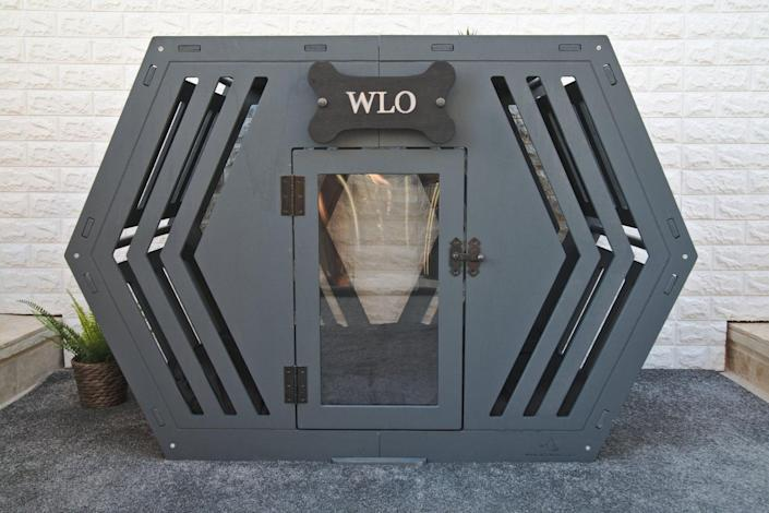 """Arguably one of the most unusually shaped crates on the market, this kennel is sure to be a conversation starter. This easy-to-assemble piece can come in four sizes, six wood colors, and with a custom cushion so that Fido is comfy and cozy. You can even have a name added to the façade, for a small fee. $279, Etsy. <a href=""""https://www.etsy.com/listing/852947582/modern-dog-house-wooden-pet-house-dog"""" rel=""""nofollow noopener"""" target=""""_blank"""" data-ylk=""""slk:Get it now!"""" class=""""link rapid-noclick-resp"""">Get it now!</a>"""