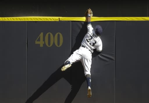 Brewers' center fielder Keon Broxton catches a ball at the wall to rob a potential home run by the Cardinals' Randal Grichuk. (AP)