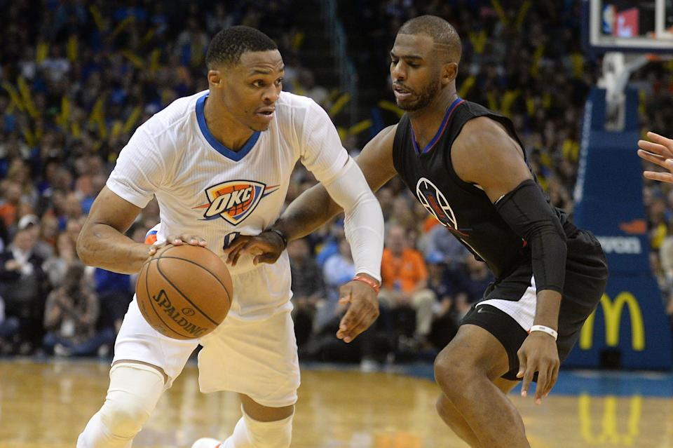Russell Westbrook (0) handles the ball against Chris Paul .
