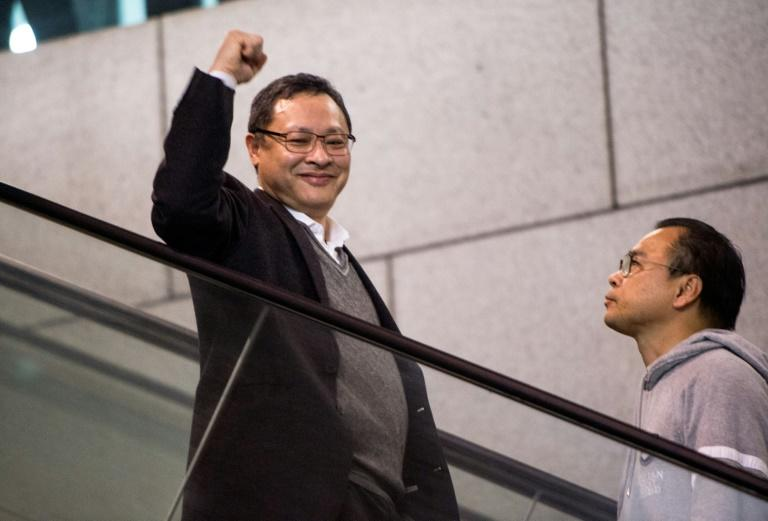 Benny Tai (L) is co-founder of Occupy Central, one of the groups behind the 2014 Umbrella Movement rallies