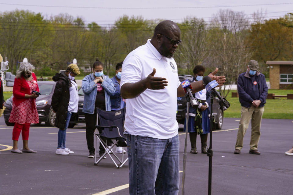 Pastor Denell Howard of the Olivet Missionary Baptist Church leads a prayer at a vigil in Indianapolis, Saturday, April 17, 2021 for the victims of the shooting at a FedEx facility. A gunman killed eight people and wounded several others before taking his own life in a late-night attack at a FedEx facility near the Indianapolis airport. (AP Photo/Michael Conroy)