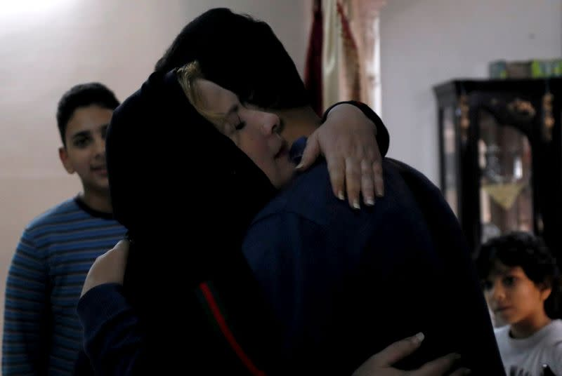 Palestinian journalist, Yaghi, hugs his mother after 20 years of separation in Banha