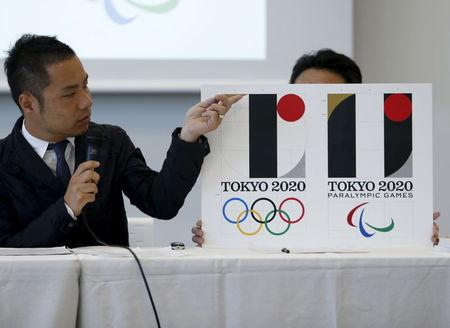 Kenjiro Sano, designer of Tokyo 2020 Olympic and Paralympic Games logos, explains about the designs during a news conference in Tokyo