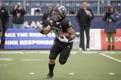 Nevada running back Toa Taua (35) runs against UNLV in the first half of an NCAA college football game in Reno, Nev., Saturday, Nov. 30, 2019. (AP Photo/Tom R. Smedes)