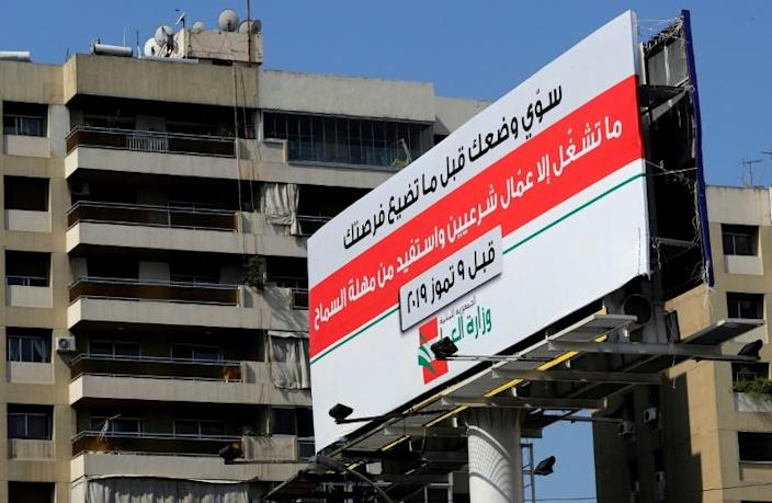 """""""Don't employ illegals"""" - labour ministry warnings erected across Lebanon seek to persuade businesses it is no longer worth the risk of employing cheaper, Syrian staff without work permits (AFP Photo/JOSEPH EID)"""