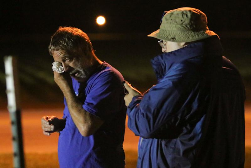 Anti-death penalty supporter Randy Gardner, left, wipes away a tear - Credit: AP