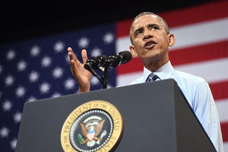 US President Barack Obama speaks at the Paramount Theatre in Austin, Texas, on July 10, 2014
