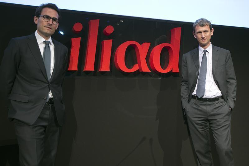 Maxime Lombardini, Chief Executive Officer of French broadband Internet provider Iliad, and Thomas Reynaud, Chief Financial Officer of Iliad, pose before a presentation in Paris