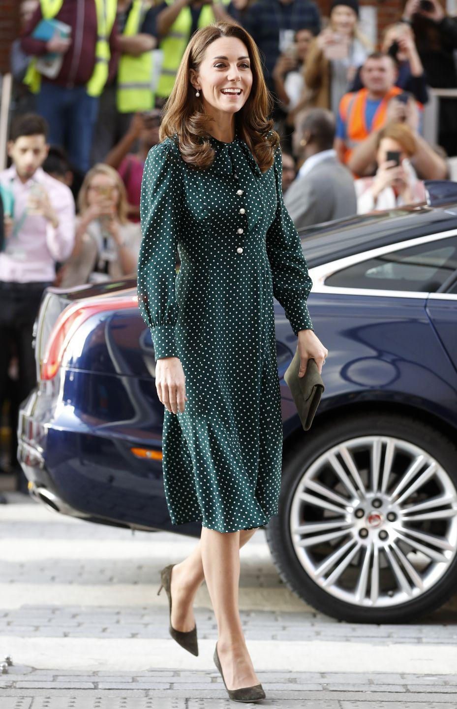 "<p>For a day of engagements, Kate stepped out in <a href=""https://go.redirectingat.com?id=74968X1596630&url=https%3A%2F%2Fus.lkbennett.com%2Fproduct%2FDRMORTIMERSILKPrintGreen%7EMortimer-Dotted-Silk-Dress-Green&sref=https%3A%2F%2Fwww.townandcountrymag.com%2Fstyle%2Ffashion-trends%2Fnews%2Fg1633%2Fkate-middleton-fashion%2F"" rel=""nofollow noopener"" target=""_blank"" data-ylk=""slk:a festive green polka dot dress"" class=""link rapid-noclick-resp"">a festive green polka dot dress</a> and paired the look with an olive clutch and matching heels.</p><p><a class=""link rapid-noclick-resp"" href=""https://go.redirectingat.com?id=74968X1596630&url=https%3A%2F%2Fus.lkbennett.com%2Fproduct%2FDRMORTIMERSILKPrintGreen%7EMortimer-Dotted-Silk-Dress-Green&sref=https%3A%2F%2Fwww.townandcountrymag.com%2Fstyle%2Ffashion-trends%2Fnews%2Fg1633%2Fkate-middleton-fashion%2F"" rel=""nofollow noopener"" target=""_blank"" data-ylk=""slk:Shop the Dress"">Shop the Dress</a></p>"