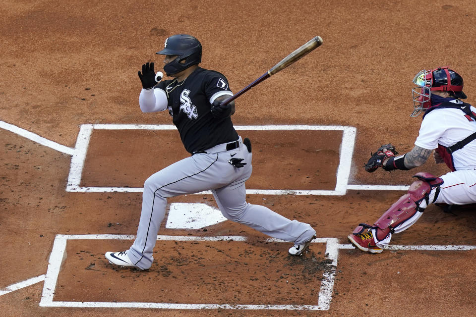 FILE - In this April 18, 2021, file photo, Chicago White Sox's Yermin Mercedes swings at a pitch next to Boston Red Sox's Christian Vazquez during a baseball game in Boston. One day after announcing he was stepping away from baseball, Mercedes was back with the White Sox's Triple-A affiliate. (AP Photo/Steven Senne, File)