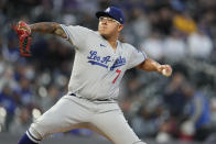 Los Angeles Dodgers starting pitcher Julio Urias works against the Colorado Rockies in the first inning of a baseball game Tuesday, Sept. 21, 2021, in Denver. (AP Photo/David Zalubowski)
