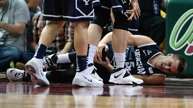 LAS VEGAS, NV - MARCH 11: Kyle Collinsworth #5 of the Brigham Young Cougars holds his knee after injuring it during the championship game of the West Coast Conference Basketball tournament against the Gonzaga Bulldogs at the Orleans Arena on March 11, 2014 in Las Vegas, Nevada. Gonzaga won 75-64. (Photo by Ethan Miller/Getty Images)