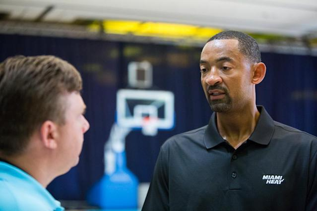 Juwan Howard talks with Tim Reynolds about transitioning from life as a player to life as an assistant coach Wednesday Oct. 2, 2013 at the Atlantis Resort in Paradise Island, Bahamas after practice. Howard is starting his first season as a Heat assistant coach, turning down other job opportunities to stay in Miami and start a path that he hopes eventually leads to him taking over his own team. He spent the last three years of his playing career with Miami, winning his first two championship rings. (AP Photo/Bahamas Visual Services, Dante Carrer)