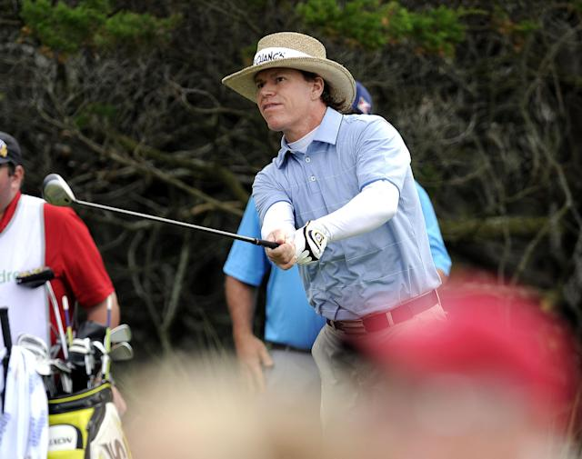Briny Baird watches his ball after hitting from the second tee during the final round of the McGladrey Classic golf tournament on Sunday, Nov. 10, 2013, in St. Simons Island, Ga. (AP Photo/Stephen Morton)
