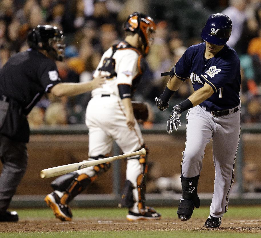 Milwaukee Brewers' Norichika Aoki tosses his bat after flying out on a pitch from San Francisco Giants' Madison Bumgarner in the sixth inning of a baseball game Wednesday, Aug. 7, 2013, in San Francisco. (AP Photo/Ben Margot)