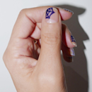 A spiderweb on clean nails looks modern, not cheesy.
