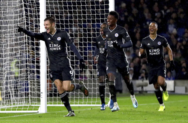 Leicester City's Jamie Vardy celebrates scoring his side's second goal of the game with a penalty, during the English Premier League soccer match between Brighton and Hove and Leicester City, at the AMEX Stadium, in Brighton, England, Saturday, Nov. 23, 2019. (Gareth Fuller/PA via AP)