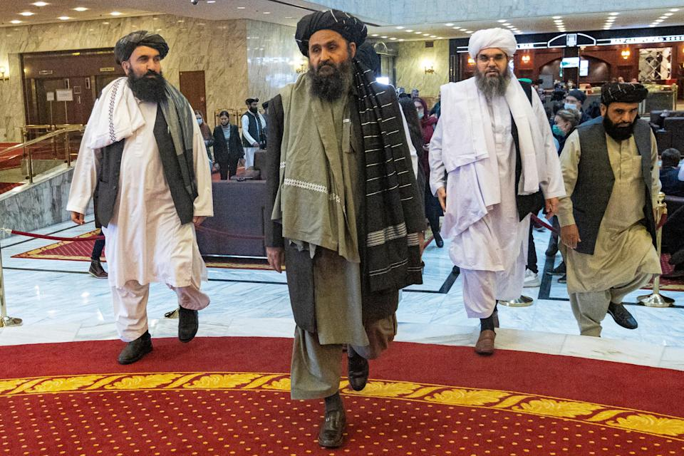 Taliban co-founder Mullah Abdul Ghani Baradar, center, at an international peace conference in Russia in March (AP)