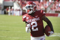 Arkansas defensive back Kamren Curl returns an interception against Portland State in the first half of an NCAA college football game, Saturday, Aug. 31, 2019 in Fayetteville, Ark. (AP Photo/Michael Woods)