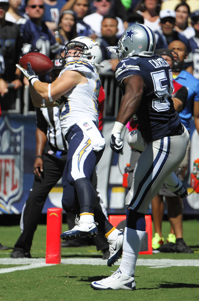 San Diego Chargers running back Danny Woodhead, left, catches a touch down pass in front on Dallas Cowboys outside linebacker Bruce Carter during the first half of an NFL football game Sunday, Sept. 29, 2013, in San Diego. (AP Photo/Denis Poroy)