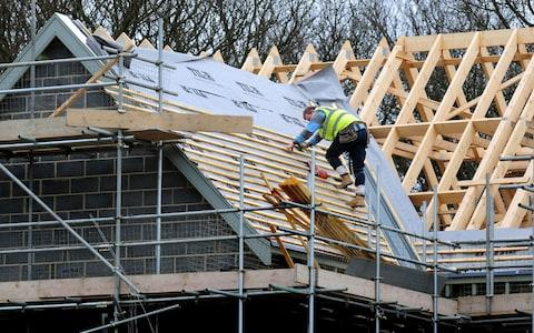 roof workers building new houses in Derbyshire - Credit: Rui Vieira/PA