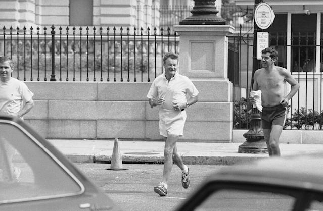 <p>Pres. Jimmy Carters National Security Adviser Zbigniew Brzezinski, left, and his aide Jerrold Schecter share a morning jog just outside the White House, Monday, Aug. 6, 1979, Washington, D.C. The two braved Washingtons heat and humidity for their run. (Photo: Ira Schwarz/AP) </p>