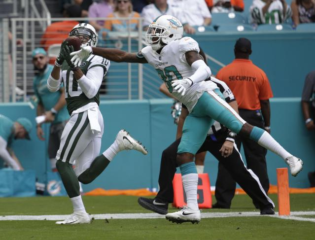 <p>New York Jets wide receiver Jermaine Kearse (10) catches a touchdown pass as Miami Dolphins cornerback Cordrea Tankersley (30) attempts to defend, during the first half of an NFL football game, Sunday, Oct. 22, 2017, in Miami Gardens, Fla. (AP Photo/Lynne Sladky) </p>