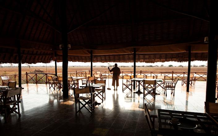 Pete Maithya, hotel worker, at the practically deserted Ngutuni Lodge, Tsavo East - Simon Townsley