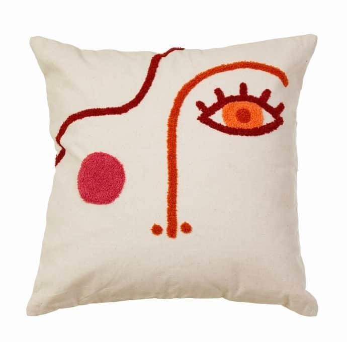 """Another cushion. This time with a curiously abstract face illustration.<br><br><strong>Cositas</strong> Tufted Abstract Face Cushion, $, available at <a href=""""https://www.trouva.com/products/tufted-abstract-face-cushion"""" rel=""""nofollow noopener"""" target=""""_blank"""" data-ylk=""""slk:Trouva"""" class=""""link rapid-noclick-resp"""">Trouva</a>"""