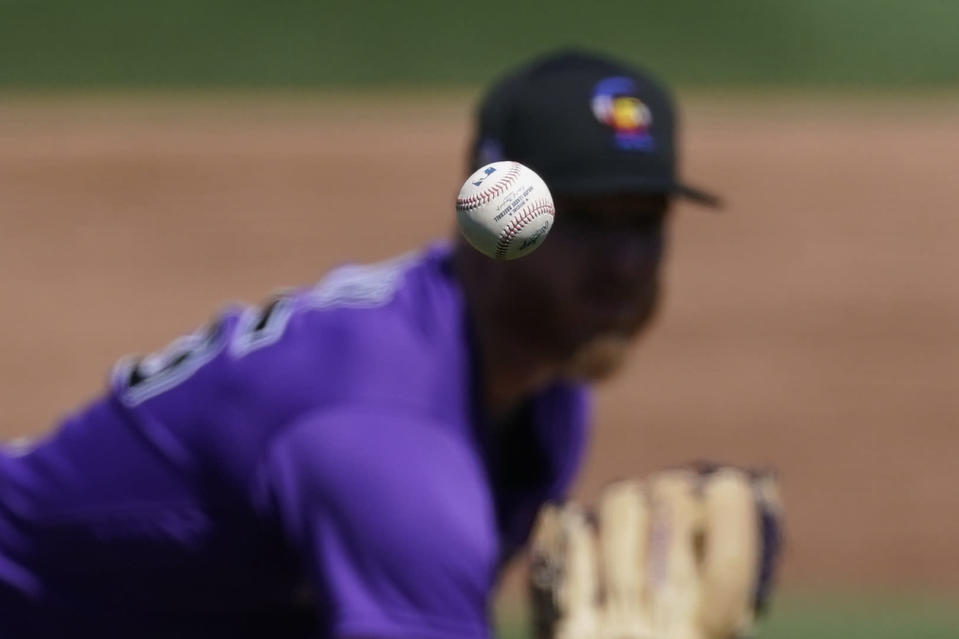 Colorado Rockies starting pitcher Jon Gray (55) throws during the second inning of a spring training baseball game against the Milwaukee Brewers Wednesday, March 24, 2021, in Phoenix. (AP Photo/Ashley Landis)