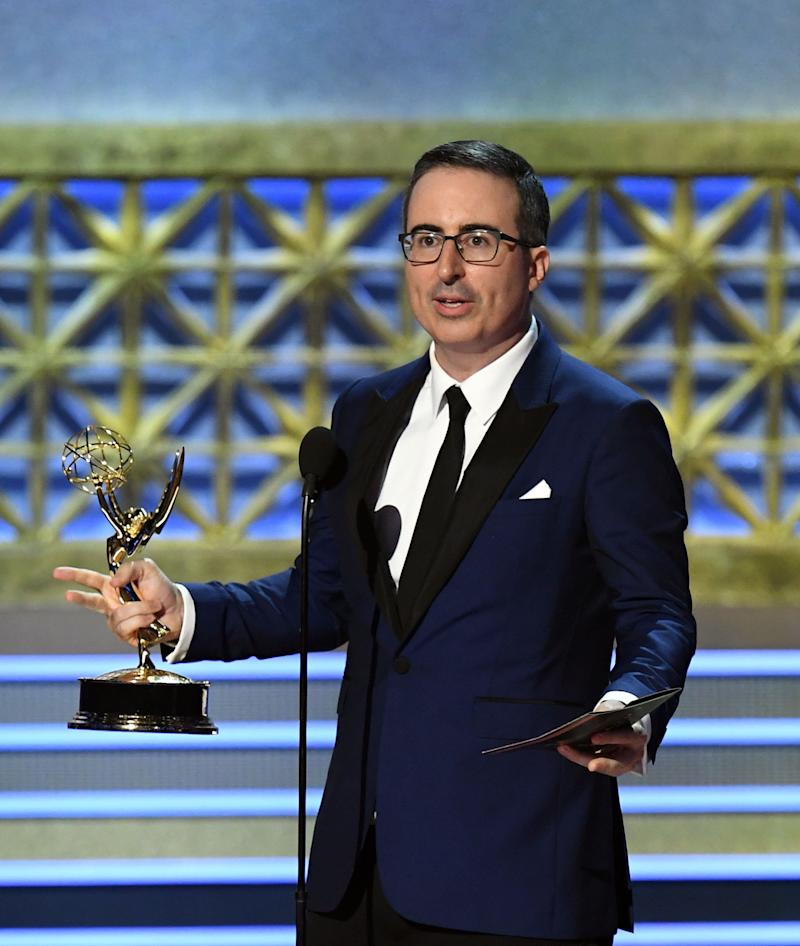 "Host John Oliver accepts the Outstanding Writing for a Variety Series for ""Last Week Tonight with John Oliver"" onstage during the 69th Annual Primetime Emmy Awards at Microsoft Theater on Sept. 17, 2017 in Los Angeles, California."