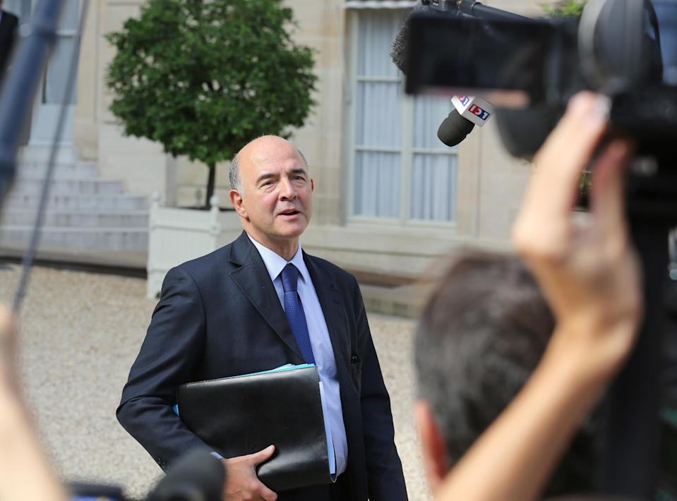 French finance minister Pierre Moscovici adresses reporters as he leaves the Elysee Palace following the weekly cabinet meeting in Paris, Wednesday Sept. 25, 2013. The French government has declared the economic crisis over and is promising that its budget for next year will bring growth and jobs, but experts are criticizing the proposal from all sides and a true rebound looks way off.(AP Photo/Remy de la Mauviniere)