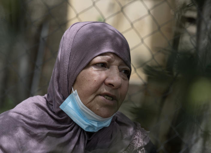 Jamila, the mother of Palestinian Osama Mansour, who was shot to death by Israeli soldiers at a temporary checkpoint in the occupied West Bank earlier this month, speaks to journalists at the family house, in the West Bank village of Biddu, west of Ramallah, Tuesday, April 20, 2021. Somaya, Mansour's wife, who was in the car with her husband and was wounded by the gunfire, said they followed the soldiers' instructions and posed no threat. The shooting death has revived criticism of the Israeli military's use of deadly force. (AP Photo/Nasser Nasser)