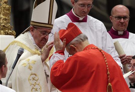 Pope Francis blesses newly elected cardinal Lorenzo Baldisseri of Italy during a consistory ceremony in Saint Peter's Basilica at the Vatican February 22, 2014. REUTERS/Max Rossi