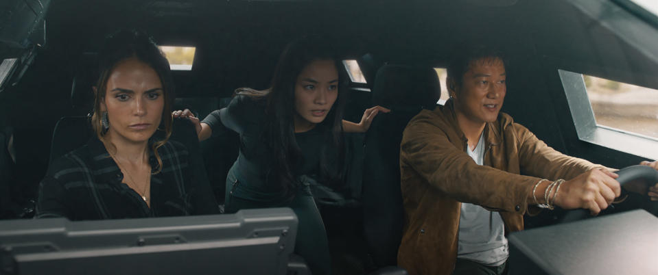 """This image released by Universal Pictures shows Jordana Brewster, from left, Anna Sawai and Sung Kang in a scene from """"F9: The Fast Saga."""" (Universal Pictures via AP)"""