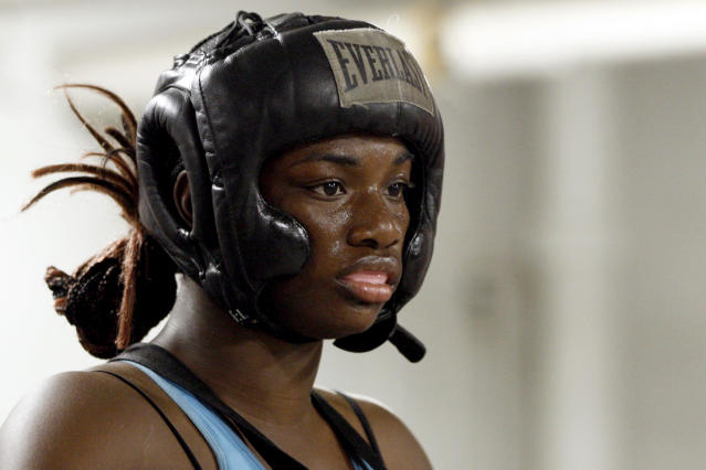 In this Sept. 18, 2012, photo, Olympic gold medal boxer Claressa Shields trains at the Berston Field House in Flint, Mich. Aside from her Olympic title and a jab that could knock someone out cold, Shields isn't much different than other high school seniors. (AP Photo/Carlos Osorio)