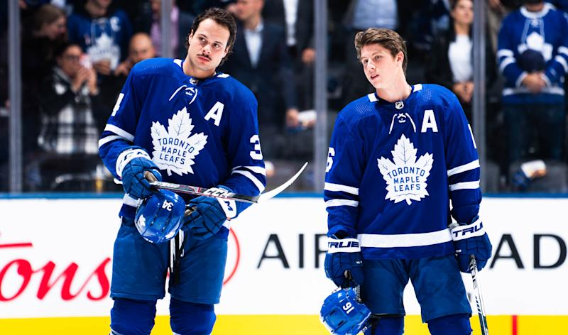 TORONTO, ON - OCTOBER 21: Auston Matthews #34 and Mitch Marner #16 of the Toronto Maple Leafs stand for the anthems before playing the Columbus Blue Jackets at the Scotiabank Arena on October 21, 2019 in Toronto, Ontario, Canada. (Photo by Mark Blinch/NHLI via Getty Images)