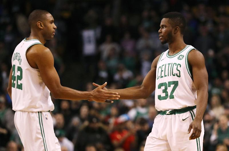 Al Horford (L) led the way with 18 points, nine rebounds and six assists as the Boston Celtics handed the Pistons their sixth straight defeat 91-81
