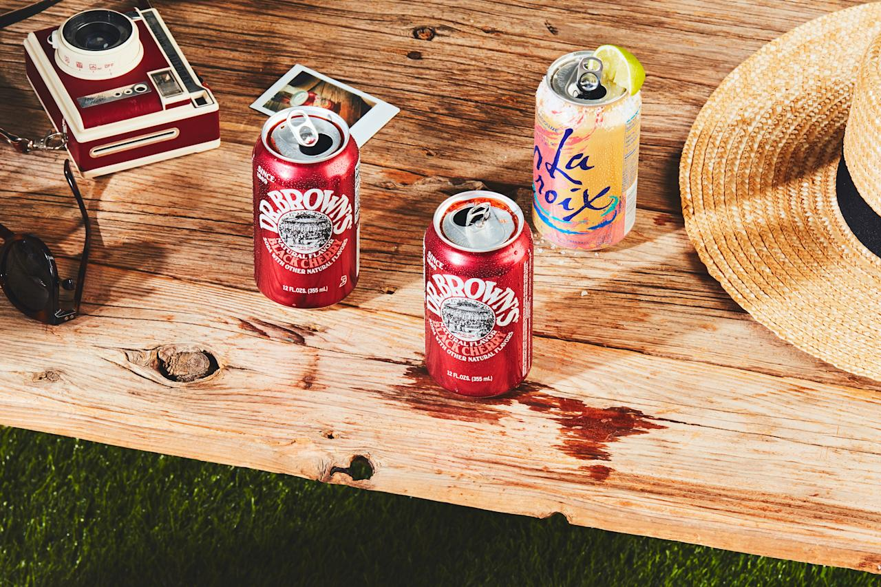 """Adding bourbon and Campari to cherry cola makes for a sweet, spicy, and refreshing backyard drink. <a href=""""https://www.epicurious.com/recipes/food/views/cherry-bourbon-soda-can-cocktail?mbid=synd_yahoo_rss"""">See recipe.</a>"""