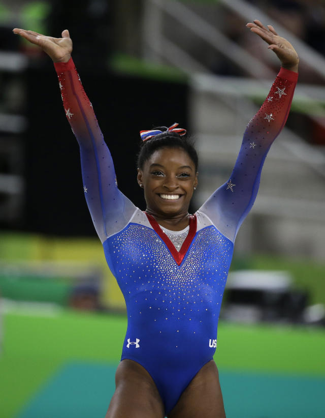 FILE - In this Tuesday, Aug. 16, 2016 file photo, United States' Simone Biles completes her routine on the floor during the artistic gymnastics women's apparatus final at the 2016 Summer Olympics in Rio de Janeiro, Brazil. Olympic swimmer Michael Phelps and Oklahoma City Thunder star Russell Westbrook are among the finalists for best male athlete at the ESPY Awards. Tennis star Serena Williams and gymnast Simone Biles are two of the finalists for best female athlete. (AP Photo/Rebecca Blackwell, File)