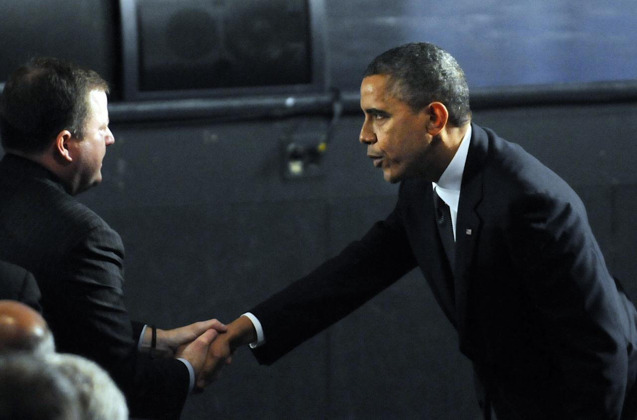NEWTOWN, CT - DECEMBER 16:  U.S. President Barack Obama is greeted by R-Fairfield, John McKinney, the Ct. Senate minority leader, before being seated in the audience for the 90 minute service on December 16, 2012 at Newtown High School in Newtown, Connecticut. Twenty-six people were shot dead, including twenty children, after a gunman identified as Adam Lanza opened fire at Sandy Hook Elementary School. Lanza also reportedly had committed suicide at the scene. A 28th person, believed to be Nancy Lanza, found dead in a house in town, was also believed to have been shot by Adam Lanza. (Photo by Stephen Dunn-Pool/Getty Images)