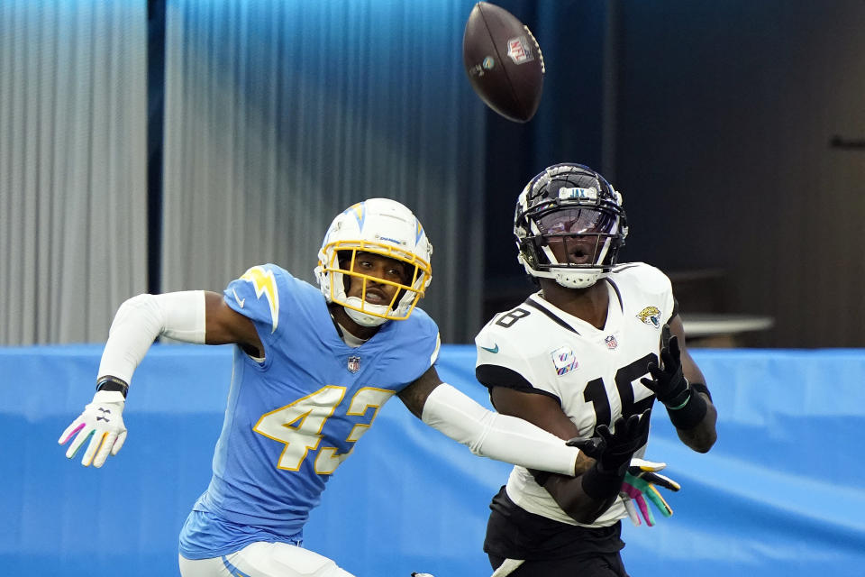 Jacksonville Jaguars wide receiver Chris Conley, right, makes a touchdown catch in front of Los Angeles Chargers cornerback Michael Davis (43) during the second half of an NFL football game Sunday, Oct. 25, 2020, in Inglewood, Calif. (AP Photo/Alex Gallardo )
