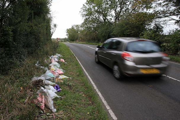 PHOTO: Floral tributes lay on the roadside near RAF Croughton in Northamptonshire, England, Oct. 10, 2019, at the spot where 19-year-old Harry Dunn was killed in a traffic collision on Aug. 27, 2019. (Lindsey Parnaby/AFP via Getty Images)