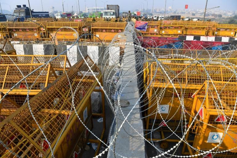 Security personnel stood guard next to police barricades at the Delhi-Uttar Pradesh state border in Ghaziabad