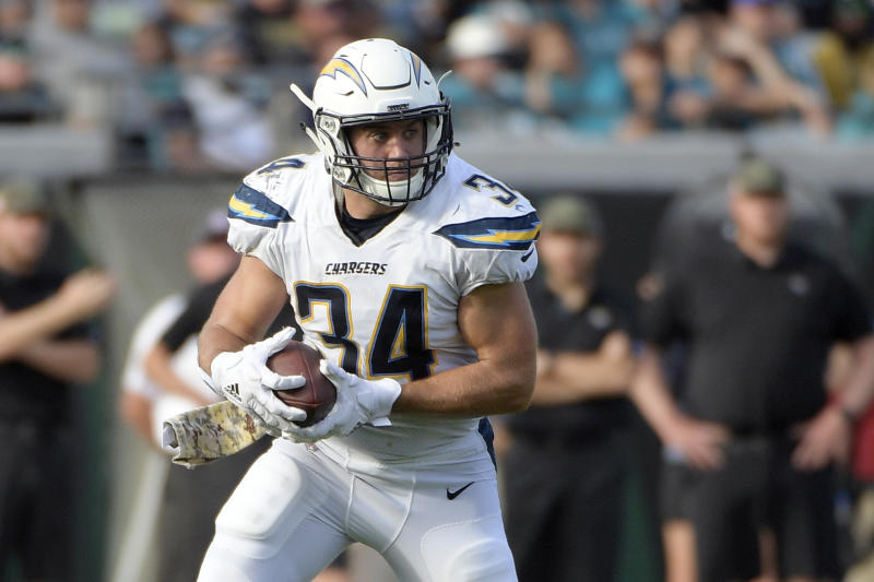 FILE - In this Nov. 12, 2017, file photo, Los Angeles Chargers fullback Derek Watt (34) runs after catching a pass during the second half of an NFL football game against the Jacksonville Jaguars in Jacksonville, Fla. Watt couldn't pass up the opportunity to play with his younger brother T.J. It's the main reason the fullback agreed to a three-year contract with the Pittsburgh Steelers. (AP Photo/Phelan M. Ebenhack, File)