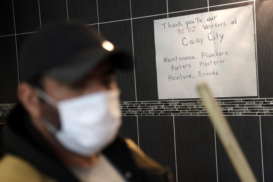 A sign thanking Co-op City employees is displayed in the lobby of a building in Co-op City in the Bronx borough of New York, Wednesday, May 13, 2020. Within the Bronx, almost no place has been hit as hard as Co-op City. Data released by city health officials Monday revealed that the virus has killed at least 155 people living in the zip code that covers the complex. That's roughly 1 of every 282 residents. (AP Photo/Seth Wenig)