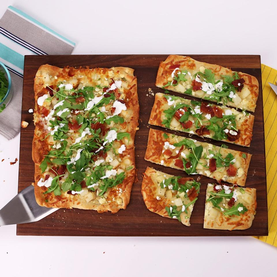 """<p>Elevate your game-day snacking with this flatbread appetizer that will be chowed down in minutes.</p> <p><strong>Get the recipe:</strong> <a href=""""https://www.popsugar.com/food/Bacon-Blue-Cheese-Flatbread-Recipe-Video-33346122"""" class=""""ga-track"""" data-ga-category=""""Related"""" data-ga-label=""""http://www.popsugar.com/food/Bacon-Blue-Cheese-Flatbread-Recipe-Video-33346122"""" data-ga-action=""""In-Line Links"""">Bacon, Blue Cheese, and Arugula Flatbread</a> </p>"""
