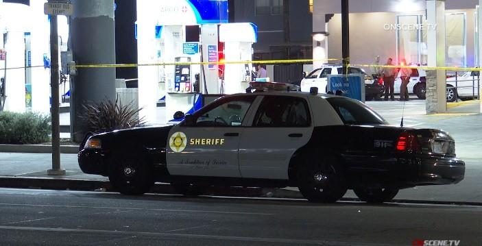 Los Angeles County Sheriff's Department officials investigate a scene in Hyde Park after a deputy shot and killed a man during a traffic stop early Thursday.