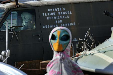 A roadside collection of alien dolls and toy UFO saucers is seen next to a roadside residence neat Jacumba, California, United States, October 7, 2016. REUTERS/Mike Blake