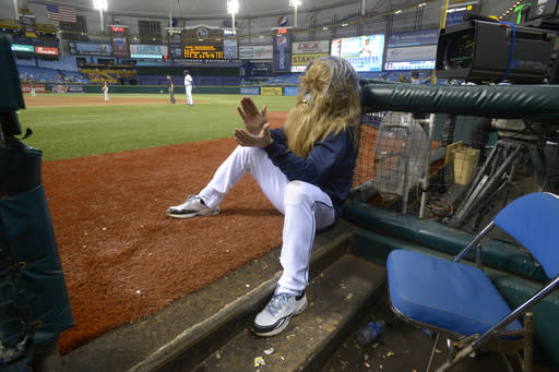 Tampa Bay Rays' Luke Scott dons a Chewbacca mask while watching from the dugout during the 18th inning of a baseball game against the Baltimore Orioles in St. Petersburg, Fla., Saturday, Sept. 21, 2013. The Rays won 5-4.(AP Photo/Phelan M. Ebenhack)